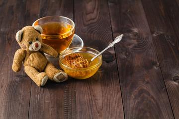 Toy teddy bear on table with honey