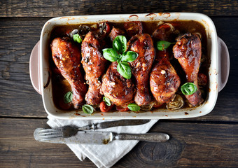 Fried chicken legs with vegetables. rustic style
