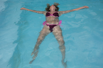 Water swimming pool relaxing girl in holiday