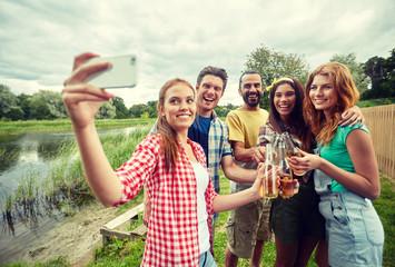 happy friends taking selfie by smartphone