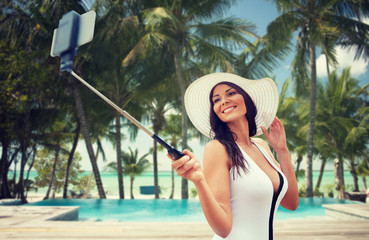 happy woman taking selfie with smartphone on beach