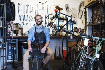 Portrait of man bicycle repair shop