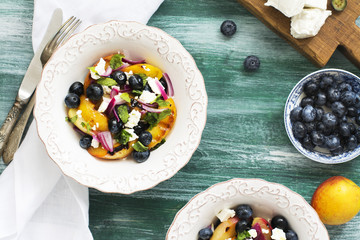 Summer salad with grilled peaches, blueberry and feta cheese