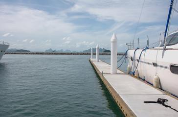 Sailboats in harbor (Docks for boats), luxury yachts and sailboats at Ao Po, Paklok ,Phuket ,Thailand