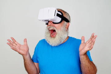 Aged man in VR-headset surprised by the picture in virtual reali