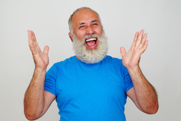 Aged stylish man laughing sincerely with hands lifted