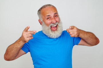 Senior man looks delighted against white background