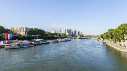 PARIS, FRANCE, on JULY 7, 2016. Urban view. The river Seine, its embankments and barges moored at the coast.