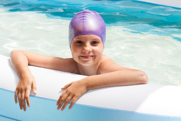 cute baby in a swimming cap. Swimming pool. Laughing baby in water