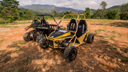 UTV off road four wheel drive sport car driving up the hill to the creek.Driving fun and safety