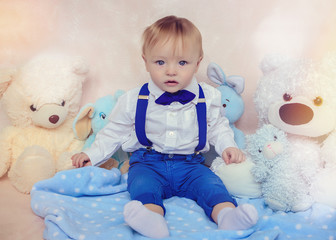 Little boy in a white shirt and bow tie