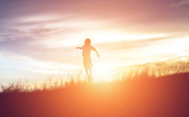 kid silhouette,Moments of the child's joy. On the Nature sunset