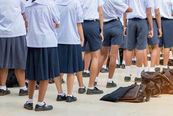 Thailand secondary education students are standing in line in th