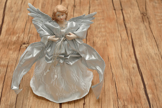 An angel dressed in silver for decorating a Christmas tree