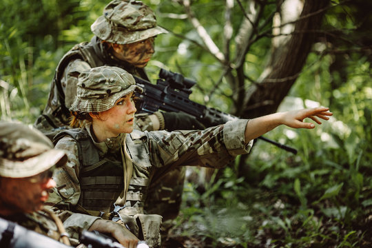 Special forces soldiers with weapon take part in military maneuv