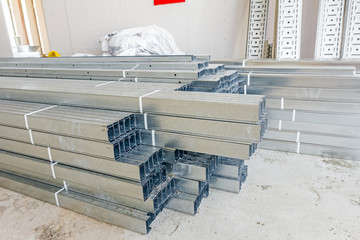 Thin square metal profiles for dry wall stacked on ground