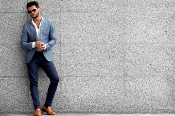 Portrait of an handsome businessman in an urban setting Wall mural