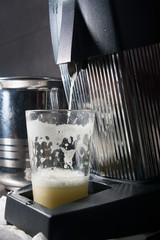 glass of fresh juice in juicer squeezer
