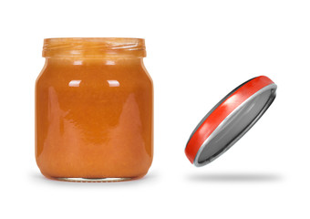 Open jar of jelly or baby food on a white background