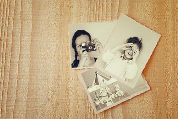 old photos over wooden textured background. vintage filtered