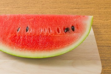 Fresh Ripe Watermelon on A Wooden Board