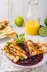 Crepes with forest berries and caramel