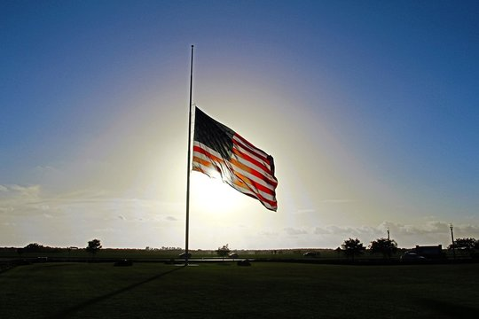 American flag at half staff.