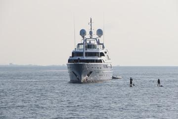 yacht in Maldives ocean, serfing