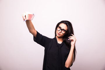 portrait of elegant woman making selfie photo on smartphone isolated on a white background
