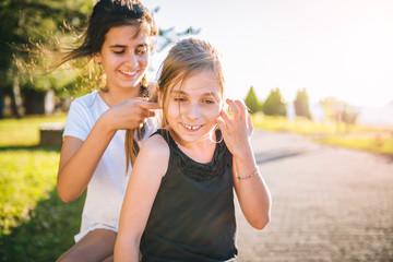 Girl making hair braid