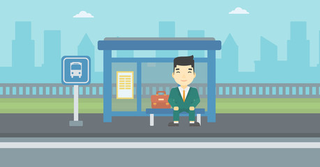 Man waiting for bus at the bus stop.