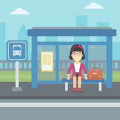 Woman waiting for bus at the bus stop.
