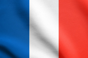 Flag of France waving in wind with fabric texture