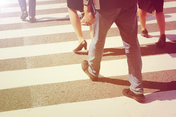 unidentified people legs crossing street