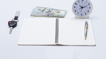 Notebook and US dollar banknote, for business concept
