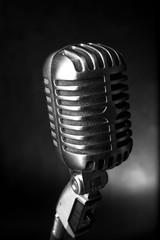 Vintage microphone on black background
