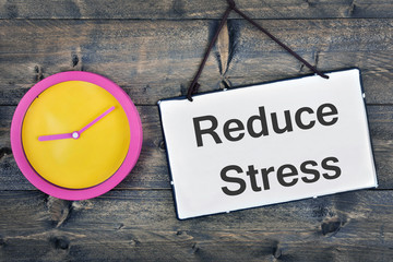 Reduce Stress sign on wooden table