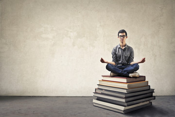 Meditation on a pile of books
