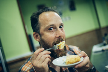 Man eating Spanish omelette