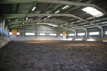 Riding hall with sandy covering without people