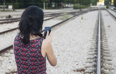 Young brunette woman using her smartphone