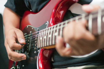 A man playing on the electric guitar