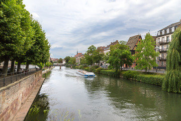 Strasbourg, France. Pleasure boat on the Ill river
