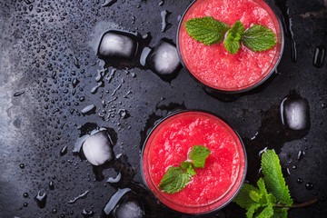 Watermelon red drink with mint on a grunge table