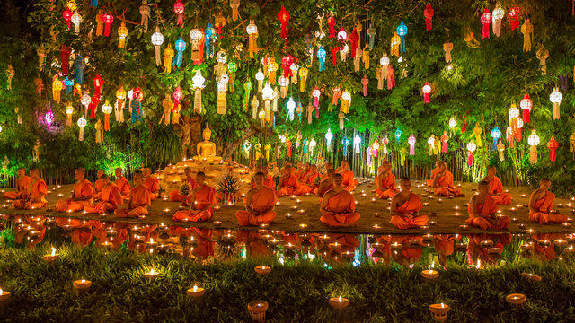 Wat Phan Tao, Chiangmai - November 9, 2014 : The monks come to take place praying and meditation on the Yee Peng  Festival's night.