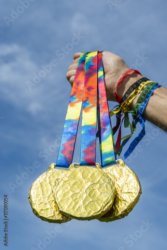 Hand of athlete wearing good luck Brazilian wish ribbons holding