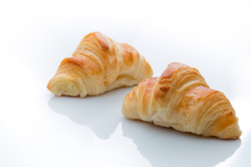 Two croissants on a white background