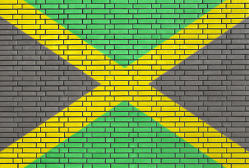 Jamaican flag painted on brick wall