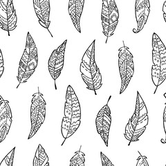 Seamless pattern with monochrome hand drawn ornate feathers