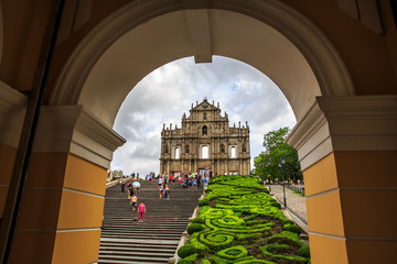 Macau, China - Jun 1, 2015 : Tourists are taking pictures at the Ruins of St. Paul Cathedral during the raining day.